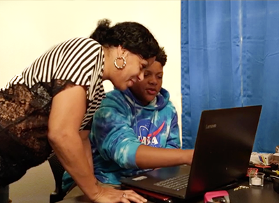 Mother and son working on a laptop.